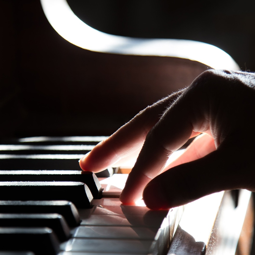 Male hand on piano keys
